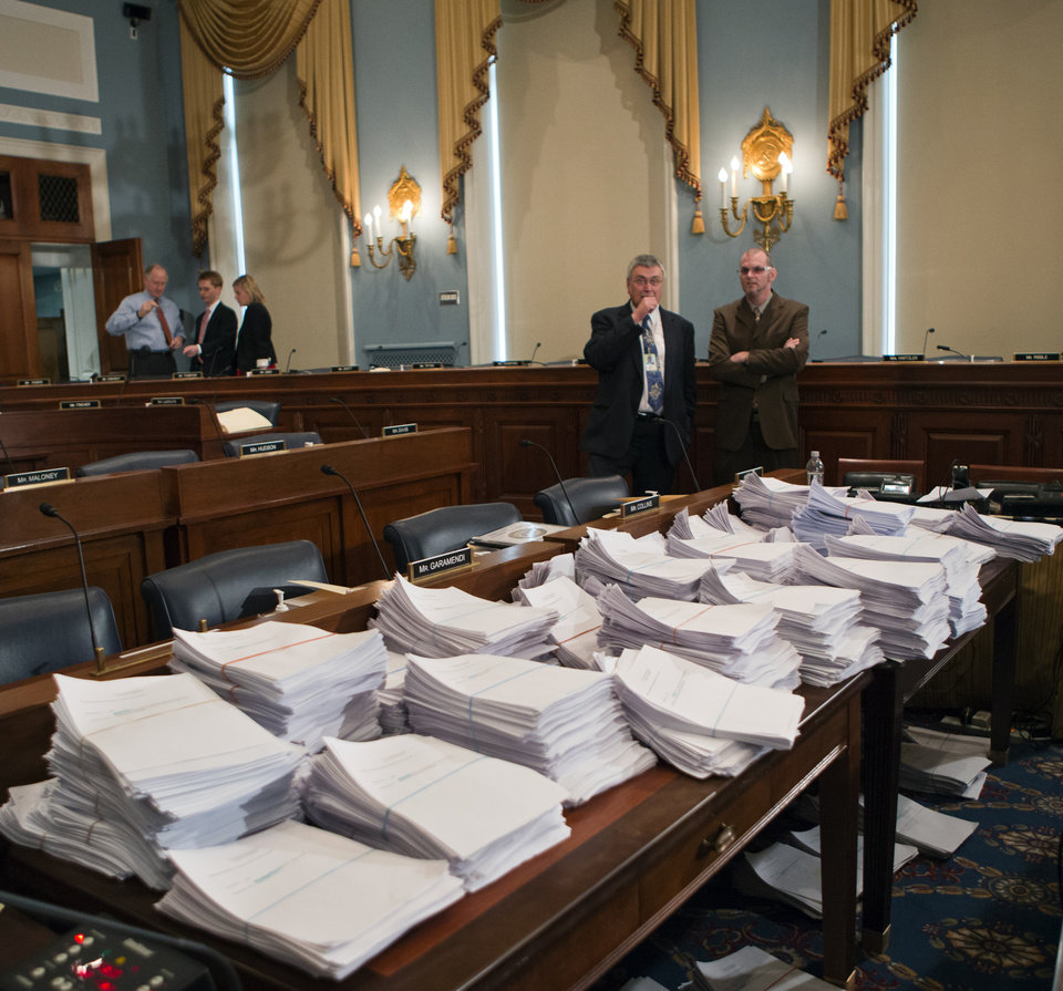 Photo - Stacks of paperwork await members of the House Agriculture Committee, on Capitol Hill in Washington, Wednesday, May 15, 2013, as it meets to consider proposals to the 2013 Farm Bill, including small cuts to the $80 billion-a-year food stamp program in an effort to appease conservatives who say the food aid has become too expensive.   (AP Photo/J. Scott Applewhite)