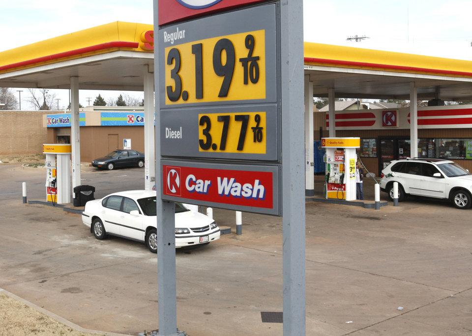 Photo - Gas prices are creeping back up, as evidenced by this sign at 63rd and Broadway Extension in Oklahoma City, OK, Friday, January 25, 2013,  By Paul Hellstern, The Oklahoman