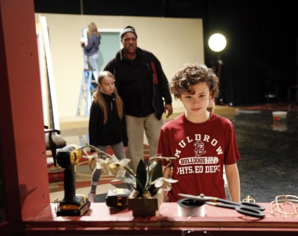 Photo -  Actors Jesse Kilinc, 11, right, Oscar Ray, center, and Lorelei Krieger, 11, rehearse a scene during preparations to film