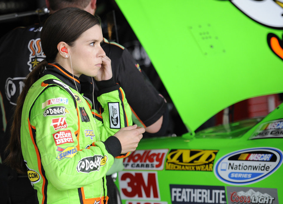Nationwide Series driver Danica Patrick puts in her ear plugs during practice for the OneMain Financial 200 NASCAR Nationwide Series auto race, Friday, Sept. 28, 2012, in Dover, Del. (AP Photo/Nick Wass)