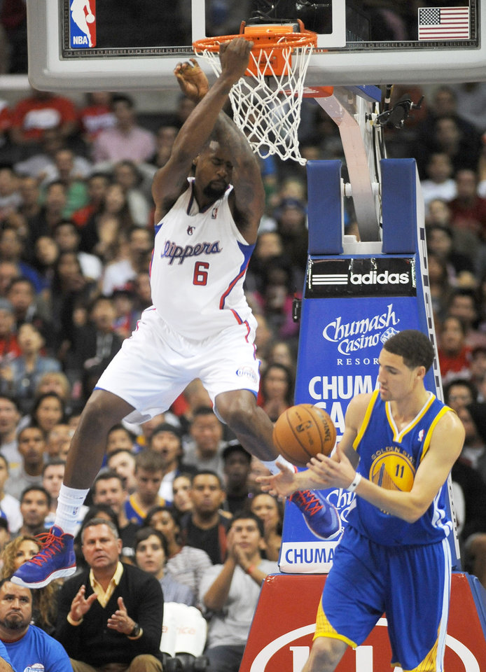 Photo -   Los Angeles Clippers center DeAndre Jordan (6) finishes off a slam dunk as Golden State Warriors guard Klay Thompson, right, catches the ball in the first half of an NBA basketball game in Los Angeles on Saturday, Nov. 3, 2012. (AP Photo/Richard Hartog) ,