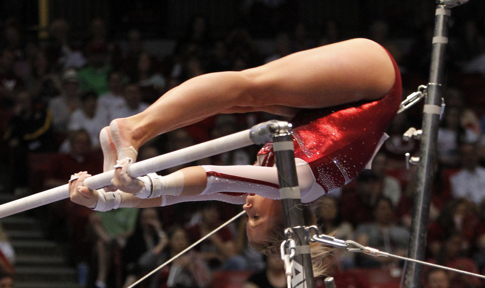 Photo - Oklahoma's McKenzie Wofford competes on the uneven bars during the NCAA college women's gymnastics championships on Saturday, April 19, 2014, in Birmingham, Ala. (AP Photo/Butch Dill)