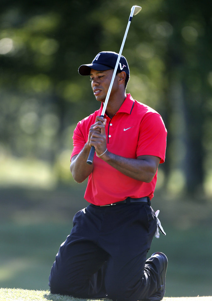 Photo -   Tiger Woods reacts after missing a putt on the 15th hole during the final round of the Deutsche Bank Championship PGA golf tournament at TPC Boston in Norton, Mass., Monday, Sept. 3, 2012. (AP Photo/Michael Dwyer)