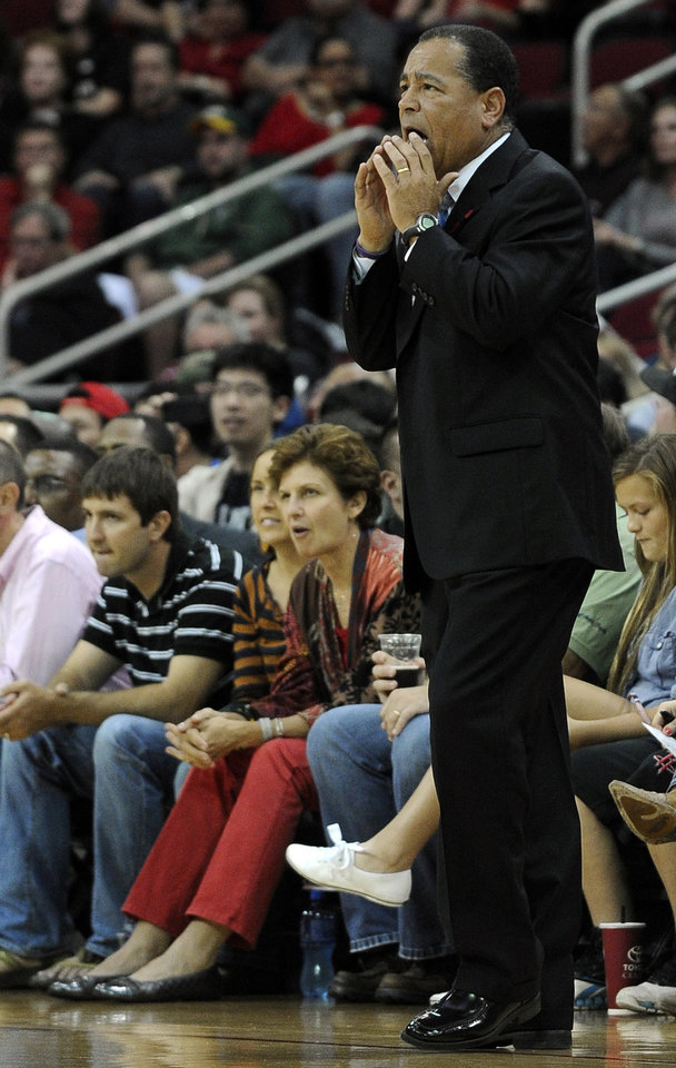 Houston Rockets acting coach Kelvin Sampson calls out to his players in the first half of an NBA basketball game against the Utah Jazz, Saturday, Dec. 1, 2012, in Houston. (AP Photo/Pat Sullivan)
