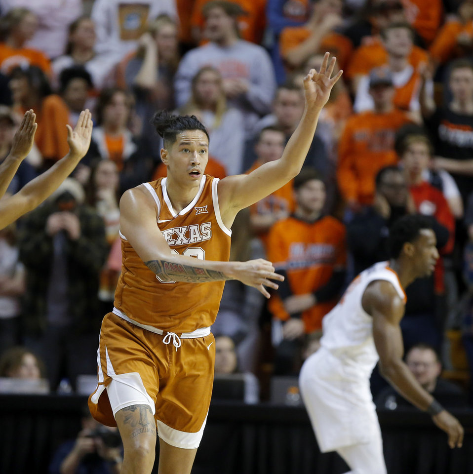 Photo - Texas' Kamaka Hepa (33) celebrates after a basket during an NCAA basketball game between the Oklahoma State University Cowboys (OSU) and the Texas Longhorns at Gallagher-Iba Arena in Stillwater, Okla., Wednesday, Jan. 15, 2020. Oklahoma State lost 76-64. [Bryan Terry/The Oklahoman]