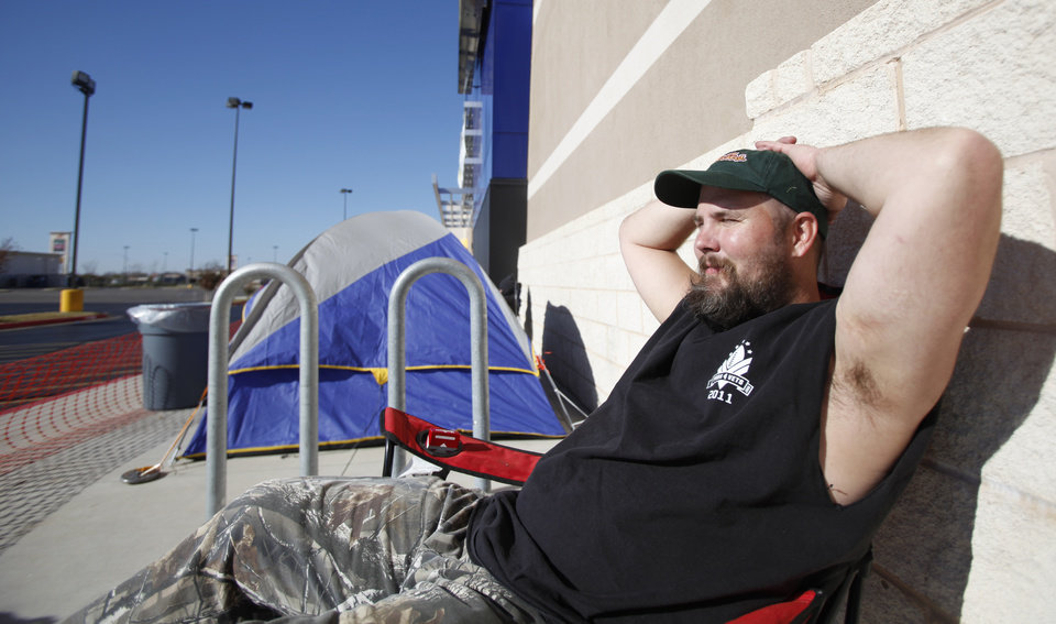 Photo - Mike Anderson waits for Black Friday shopping bargains at Best Buy on South Pennsylvania in Oklahoma City, Thursday November, 24,  2011. Oklahoman Photo by Steve Gooch