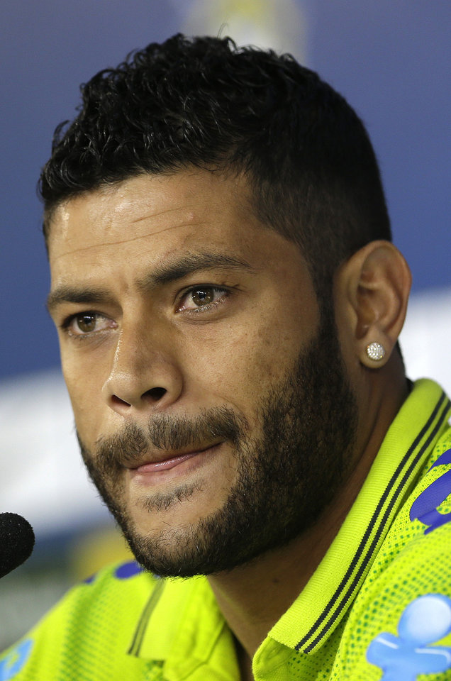 Photo - Brazil's Hulk looks listens to questions from the media during a news conference after a training session of the Brazilian national soccer team at the Granja Comary training center in Teresopolis, Brazil, Sunday, June 15, 2014. Brazil plays in group A of the 2014 soccer World Cup. (AP Photo/Andre Penner)