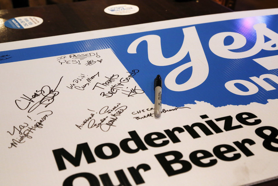 Photo - Supporters of the state question signed their names and added well wishes to this election poster. Celebrating the success of SQ 792 at the election watch party at Bricktown Brewery Tuesday night, Nov. 8, 20016, in Oklahoma City. Photo by Jim Beckel, The Oklahoman
