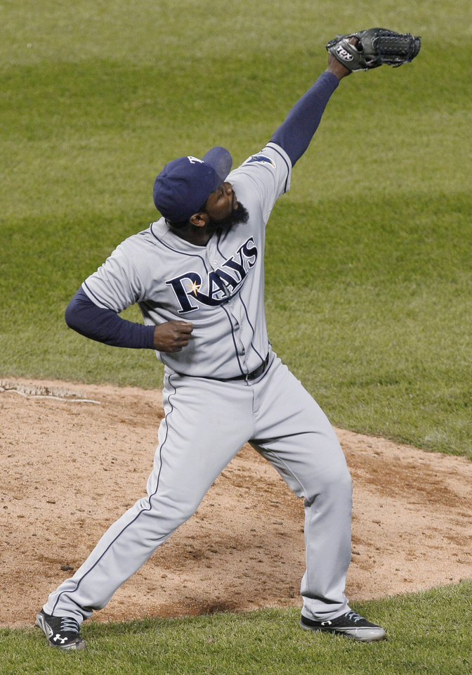 Photo -   Tampa Bay Rays closer Fernando Rodney celebrates after the Rays defeated the Chicago White Sox 3-2 in a baseball game in Chicago, Thursday, Sept. 27, 2012. (AP Photo/Nam Y. Huh)