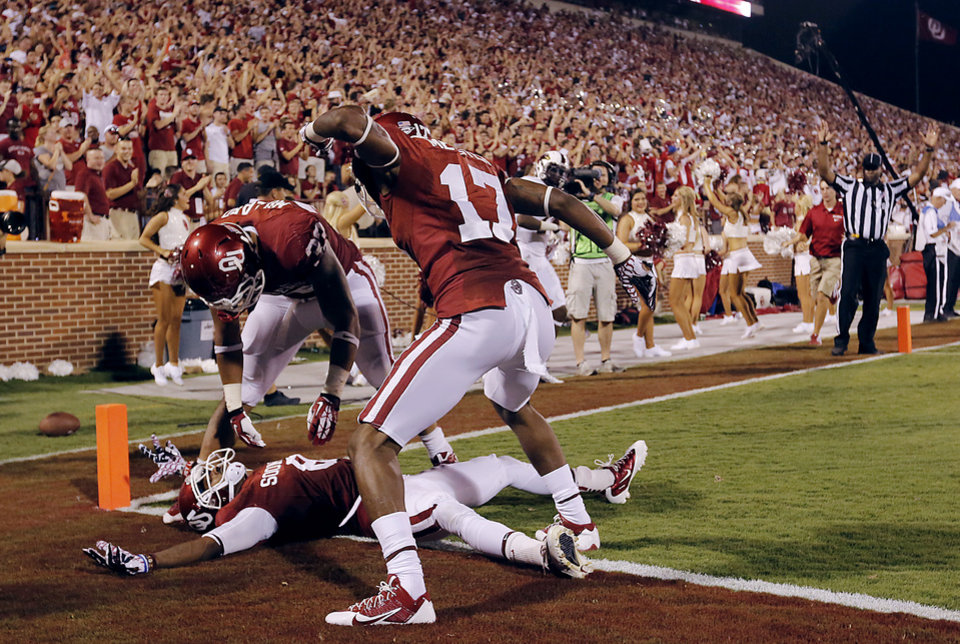 Photo - Oklahoma's Trey Millard (33), Trey Metoyer (17) and Jalen Saunders (8) celebrate after Saunders touchdown during the college football game between the University of Oklahoma Sooners (OU) and the University of Louisiana Monroe Warhawks (ULM) at the Gaylord Family Memorial Stadium on Saturday, Aug. 31, 2013 in Norman, Okla.  Photo by Chris Landsberger, The Oklahoman