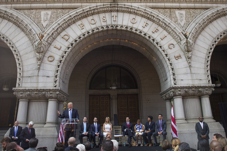 Photo - Donald Trump delivers remarks during a ground breaking ceremony for the Trump International Hotel on the site of the Old Post Office, on Wednesday, July 23, 2014, in Washington. (AP Photo)