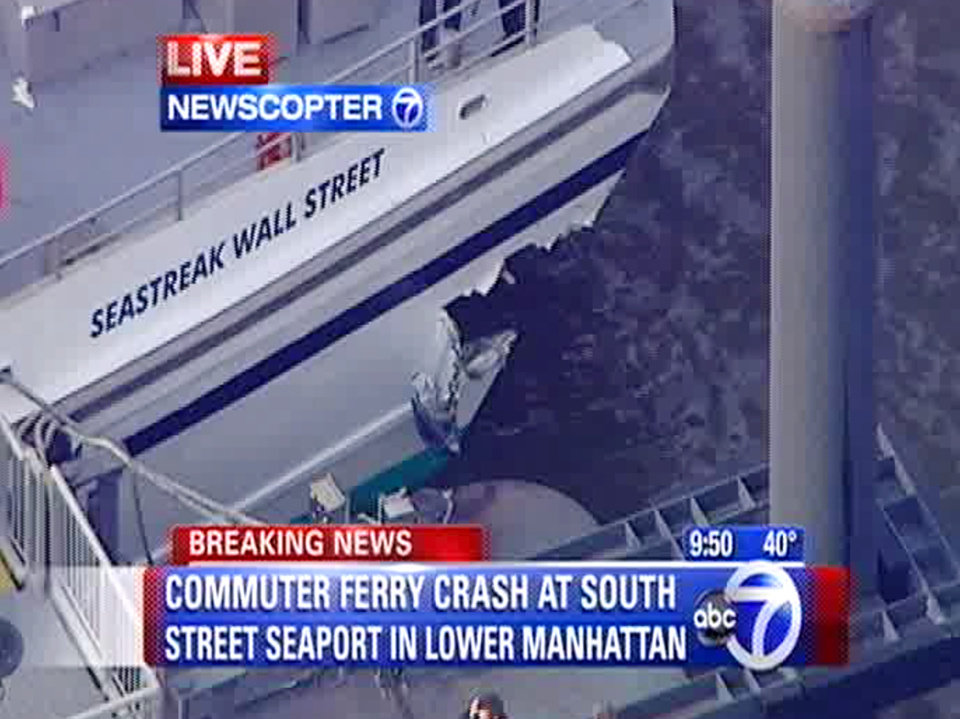 Photo - This frame grab taken from WABC News Channel 7 aerial video shows  damage to a commuter ferry in Lower Manhattan, Wednesday, Jan. 9, 2013, in New York. The Fire Department says about 17 people were injured when the ferry from New Jersey struck a dock during rush hour. (AP Photo/WABC News Channel 7)