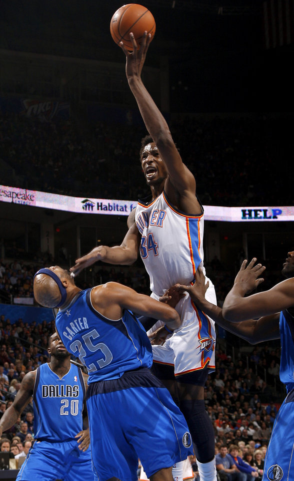 Oklahoma City's Hasheem Thabeet (34) is called for an offensive foul as he runs into Dallas' Vince Carter (25) during an NBA basketball game between the Oklahoma City Thunder and the Dallas Mavericks at Chesapeake Energy Arena in Oklahoma City, Thursday, Dec. 27, 2012.  Photo by Bryan Terry, The Oklahoman