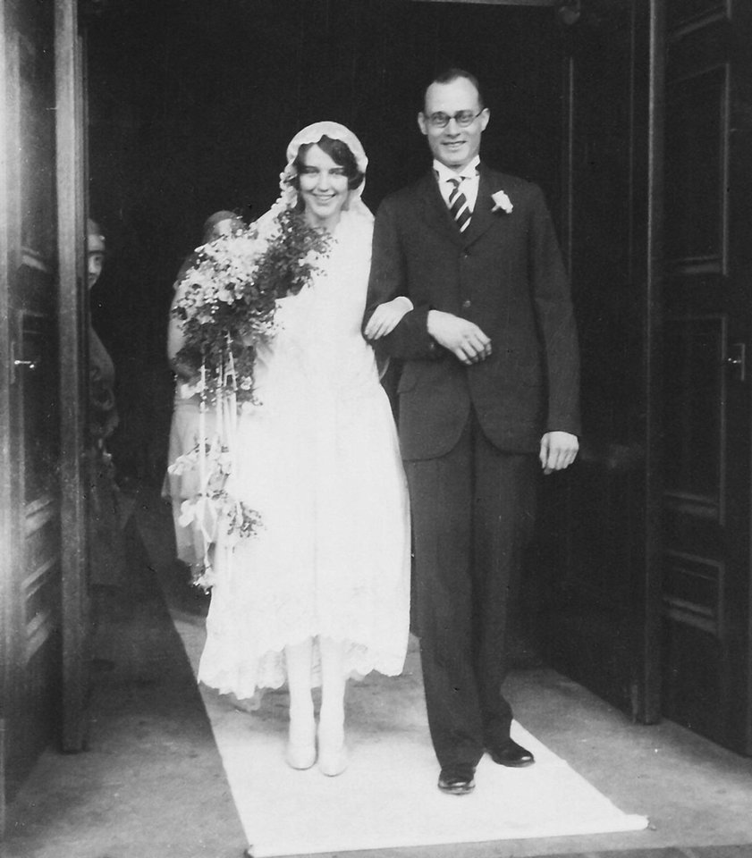 Photo - The gown Edith Pfefferle wore June 21, 1928, fit right in with the trends of the '20s. Coco Chanel introduced the world to a new style of wedding dress that featured a shorter hemline with a long tulle train. Pfefferle's hemline was finished in 10-inch-wide lace to lengthen the dress because her father wouldn't walk her down the aisle if she wore a dress with a