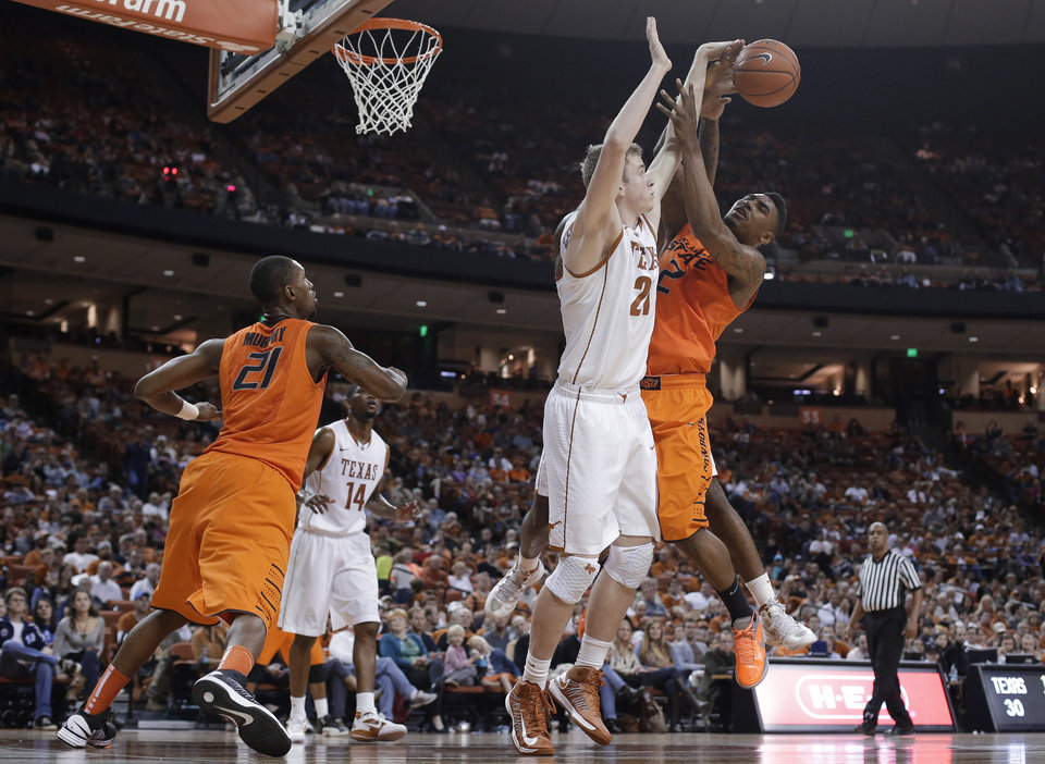 Oklahoma State\'s Le\'Bryan Nash (2) is defended by Texas\' Connor Lammert (21) as he tries to shoot during the second half of an NCAA college basketball game, Saturday, Feb. 9, 2013, in Austin, Texas. Oklahoma State won 72-59. (AP Photo/Eric Gay) ORG XMIT: TXEG112