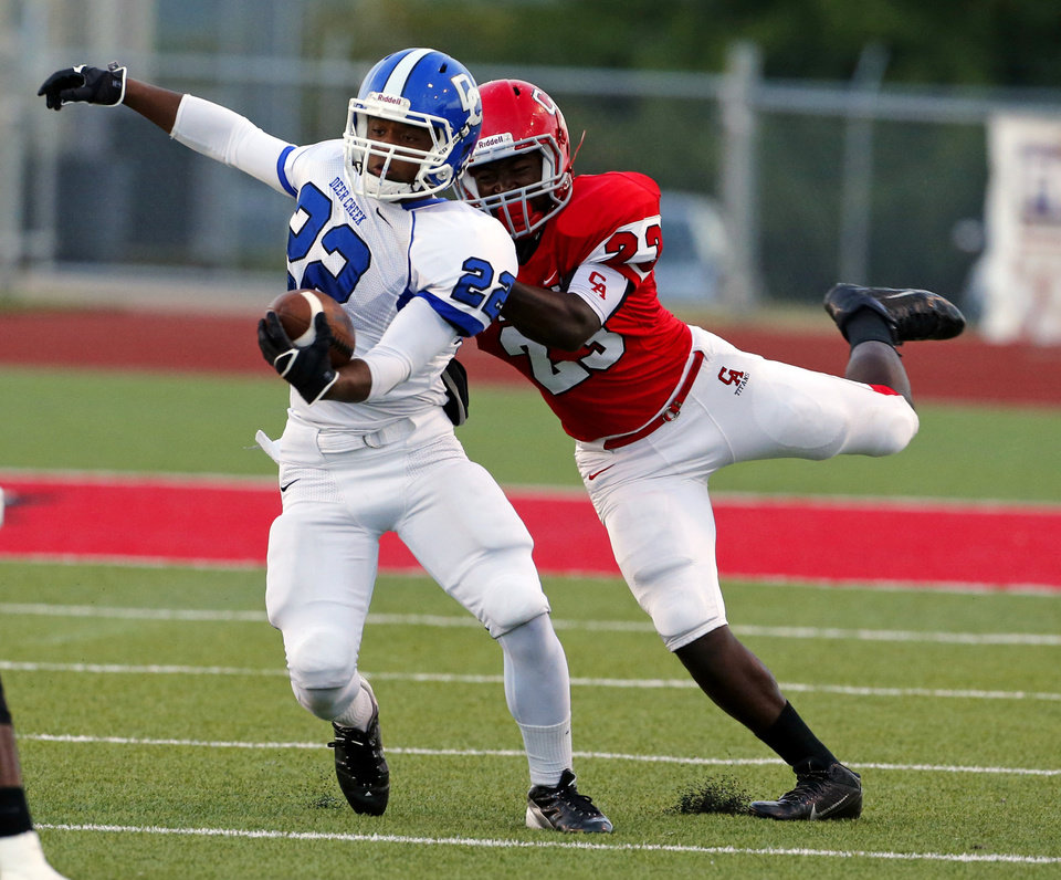 Carl Albert's Mike Mitchell stops Dee Creek's Marcus Coleman during a high school football game between the Carl Albert Titans and the Deer Creek Antlers on Friday, Sept. 27, 2013 in Midwest City, Okla. Photo by Steve Sisney, The Oklahoman