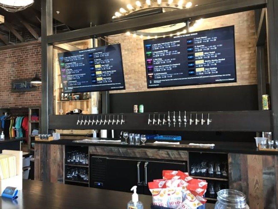Photo -  The new Frenzy taproom in downtown Edmond includes 24 taps.  [Dave Cathey/The Oklahoman]