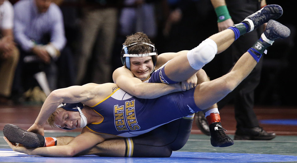 Missouri\'s Matt Manley takes on Kent State\'s Mackenzie McGuire in the 133 pound match during the 2014 NCAA Div. 1 Wrestling Championships at Chesapeake Energy Arena in Oklahoma City, Okla. on Thursday, March 20, 2014. Photo by Chris Landsberger, The Oklahoman