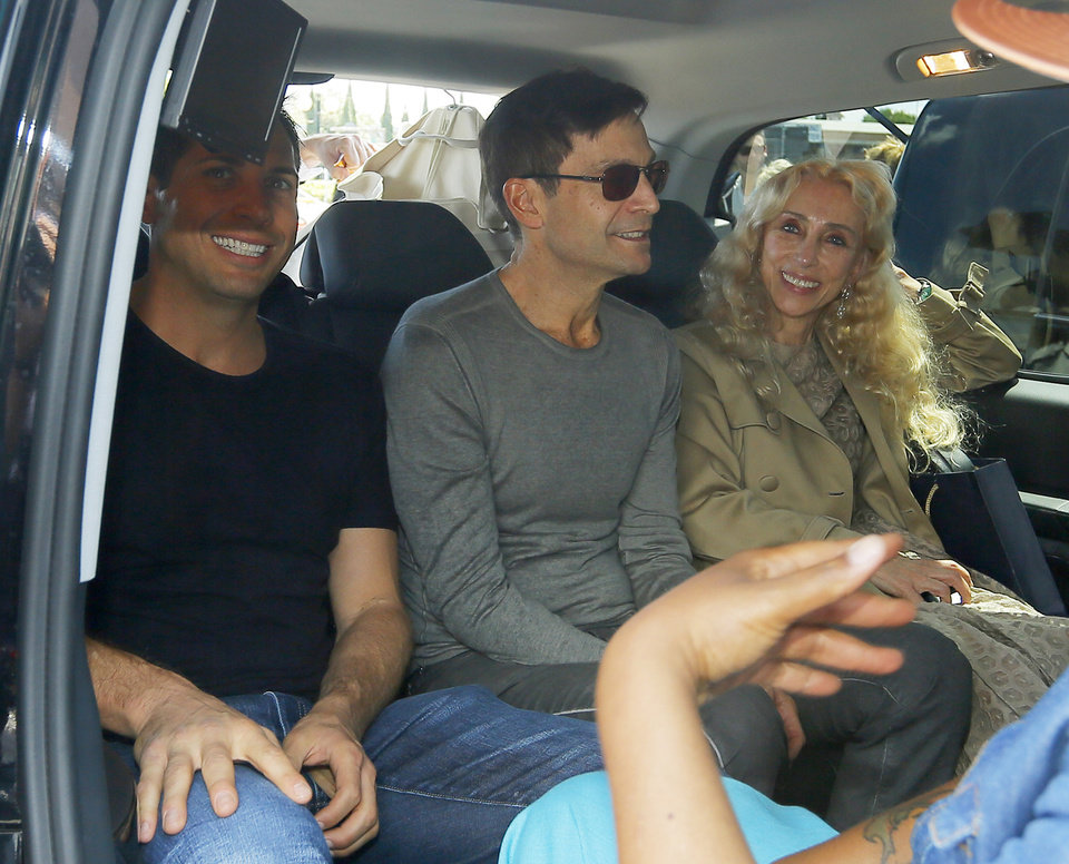 Photo - American entrepreneur and film producer Joe Francis, left, and Italian journalist and the editor-in-chief of Vogue Italia Franca Sozzani, right, arrive in Florence, Italy, Saturday, May 24, 2014. Kim Kardashian and Kanye West will wed and host a reception at Florence's imposing 16th-century Belvedere Fort on May 24, according to a spokeswoman at the Florence mayor's office. The couple rented the fort, located next to Florence's famed Boboli Gardens, for 300,000 euros ($410,000) and a Protestant minister will preside over the ceremony. Belvedere Fort was built in 1590, believed using plans by Don Giovanni de' Medici. Located near the Arno River, it offers a panoramic view of Florence and the surrounding Tuscan hills. (AP Photo/Fabio Muzzi)