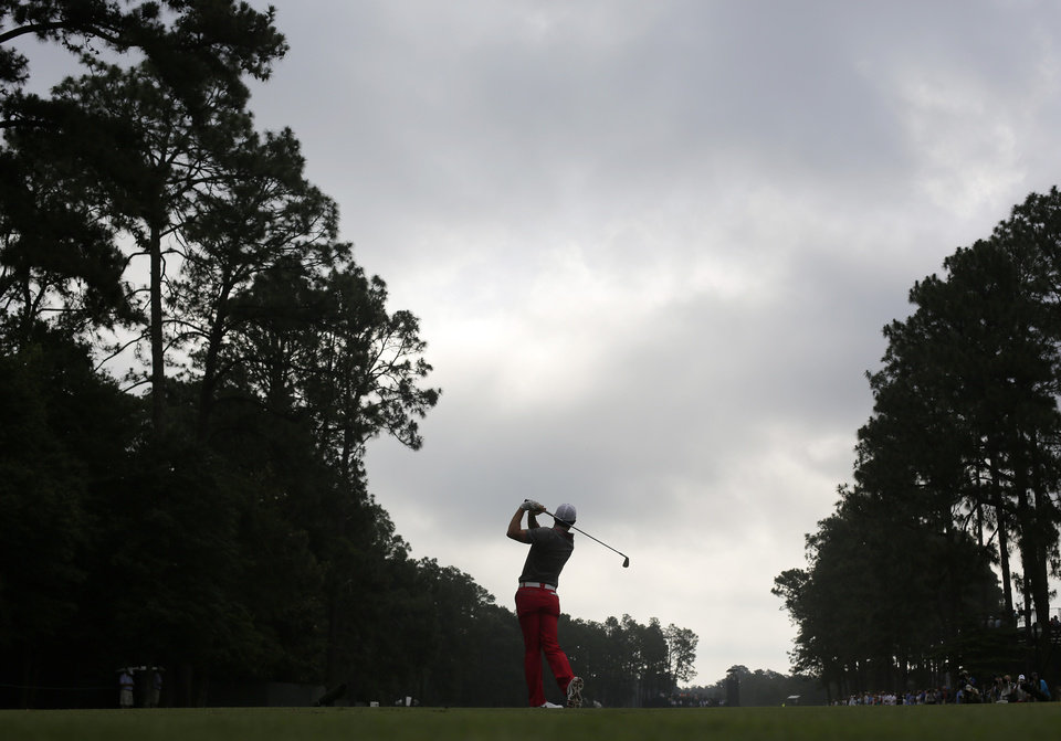 Photo - Rory McIlroy, of Northern Ireland, watches his tee shot on the third hole during the first round of the U.S. Open golf tournament in Pinehurst, N.C., Thursday, June 12, 2014. (AP Photo/Eric Gay)