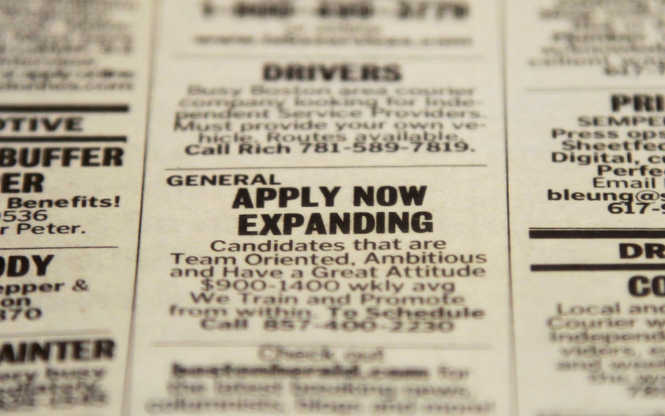 In this Tuesday, Dec. 11, 2012 photo taken in Walpole, Mass., an advertisement in the classified section of the Boston Herald newspaper calls attention to possible employment opportunities. A survey of U.S. chief executives shows the number of large companies that plan to add jobs or hire more workers is essentially unchanged versus three months ago, although fewer expect hiring to decrease. The Business Roundtable said Wednesday. Dec 12, that 29 percent of its member CEOs plan to increase hiring over the next six months, but only 29 percent expect hiring to decrease versus 34 percent in the previous report. (AP Photo/Steven Senne)