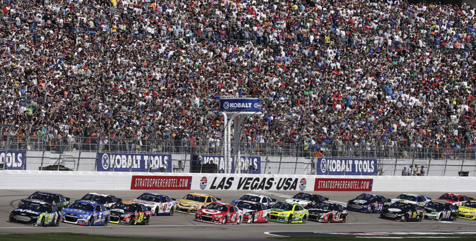 Photo - Drivers accelerate at the start of a NASCAR Sprint Cup Series auto race on Sunday, March 9, 2014, in Las Vegas. (AP Photo/Julie Jacobson)