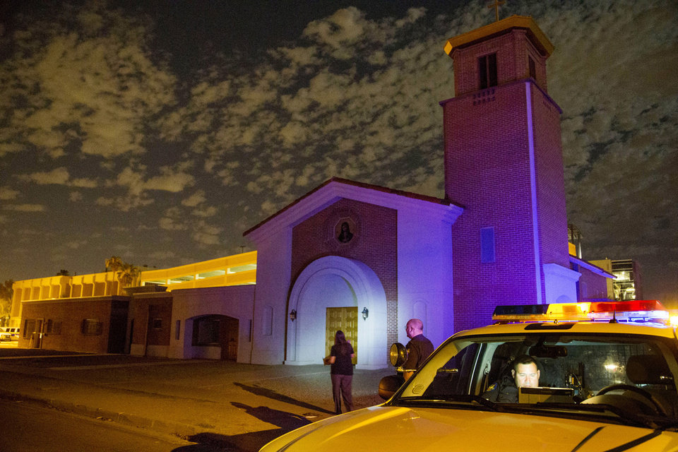 Photo - Phoenix Police investigate a shooting at Mater Misericordiae (Mother of Mercy) Mission on Wednesday, June 11, 2014 in Phoenix.  Police say one priest was shot to death and another is injured after an attack at the church in downtown Phoenix. The Roman Catholic Diocese of Phoenix on Thursday identified the slain priest as the Rev. Kenneth Walker and the injured priest as the Rev. Joseph Terra. (AP Photo/The Arizona Republic, Nick Oza)  MARICOPA COUNTY OUT; MAGS OUT; NO SALES