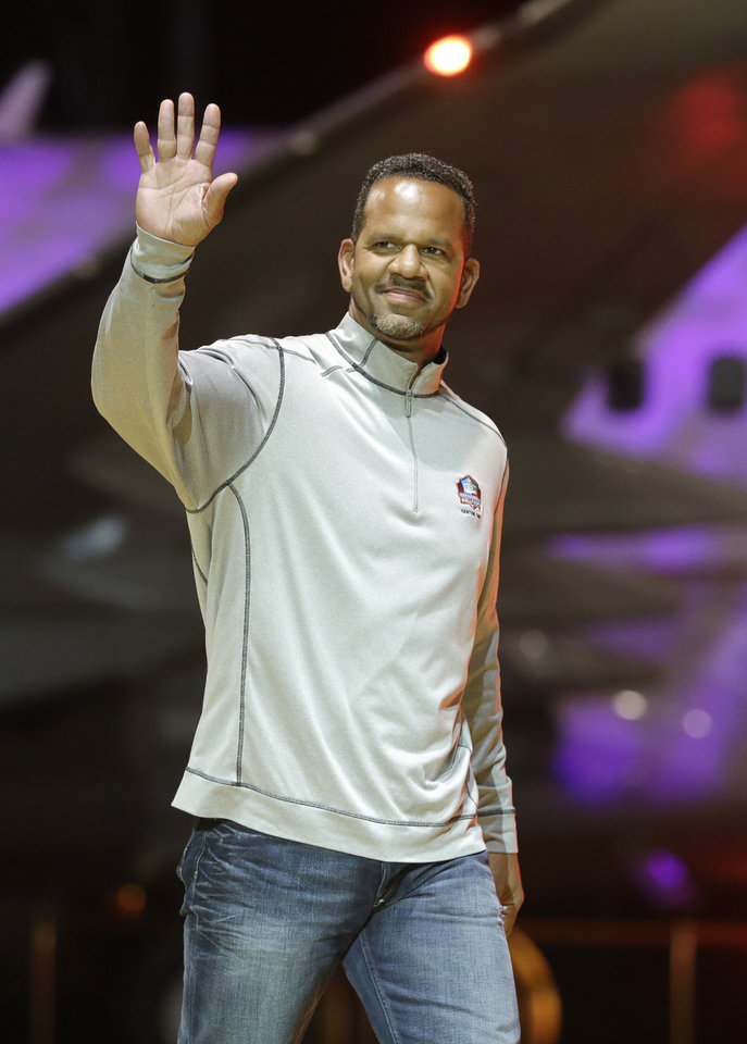 Photo - FILE - In this May 2, 2014 file photo, Andre Reed is introduced before the inaugural Pro Football Hall of Fame Fan Fest at the International Exposition Center in Cleveland. Reed awaits induction to the Pro Football Hall of Fame this weekend, and says the eight-year wait didn't feel that long. (AP Photo/Mark Duncan, File)