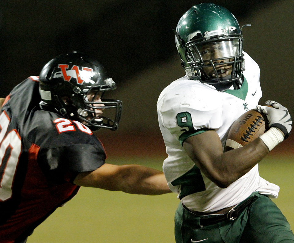 Photo - Norman North's Raymond Demby outruns Westmoore's Jake Woods during their game at Moore's stadium in Moore, Okla., on Thursday, Sept. 16, 2010. Photo by John Clanton, The Oklahoman