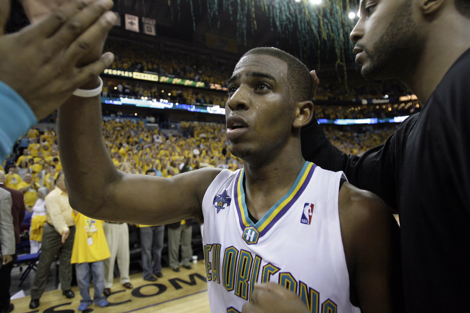 Photo - New Orleans Hornets guard Chris Paul gets high fives from teammates after game 1 of the second round of their NBA playoff basketball series with the San Antonio Spurs in New Orleans Sunday, May 4, 2008. Hornets won 101-82. (AP Photo/Alex Brandon) ORG XMIT: LAAB101