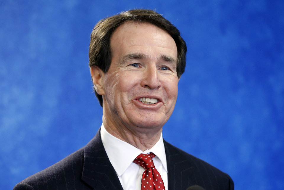 Photo - Fred Morgan, president of the State Chamber of Oklahoma, smiles as he answers a question during a news conference in Oklahoma City, Wednesday, Feb. 13, 2013. (AP Photo/Sue Ogrocki) ORG XMIT: OKSO101