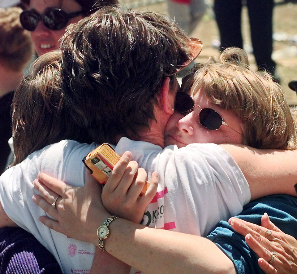 "Tornado victims, damage: Pat Harwell, (back to camera), whose home at 4221 Oakbrook was destroyed in Monday's tornado, is hugged by friends, Teri and Lisa Jamison, who live in the same neighborhood, but whose home was damaged, but ""liveable""."