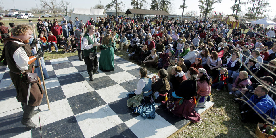 Visitors at the Camelot stage watch a performance at the 34th annual Medieval Fair at Reaves Park.  Photo by Doug Hoke, Oklahoman Archive