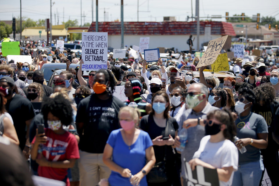 Photo - Protesters stand in a parking lot near NE 36 and Kelley in Oklahoma City on Sunday, May 31, 2020. The Black Lives Matter protest was in response to the death of George Floyd. [Bryan Terry/The Oklahoman]