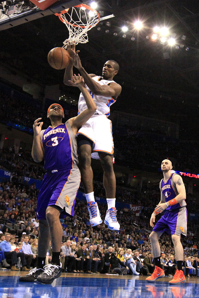 Oklahoma City's' Serge Ibaka (9) fights Phoenix 's Jared Dudley (3) for a rebound during the NBA game between the Oklahoma City Thunder and the Phoenix Suns at theChesapeake Energy Arena, Saturday, Feb. 9, 2013.Photo by Sarah Phipps, The Oklahoman