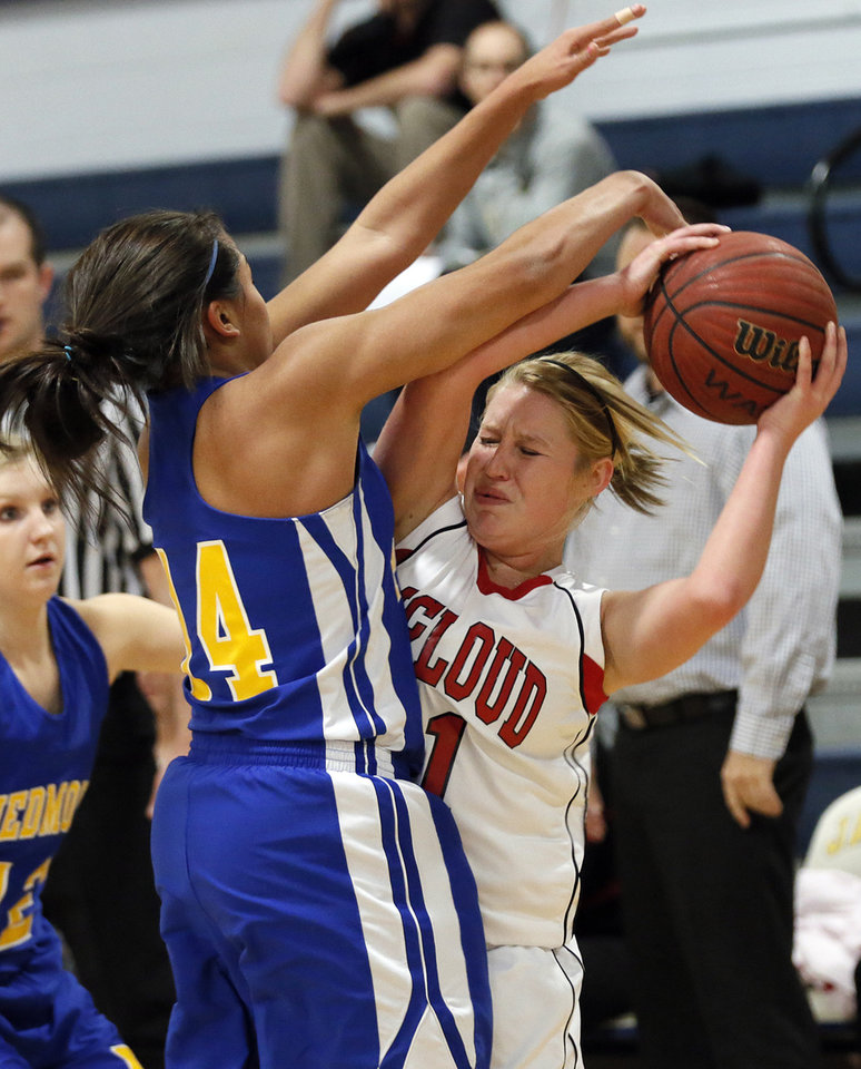 Piedmont\'s Breanu Reid (14) puts pressure on McLoud\'s Erica Hostetter (11) during a basketball tournament at the Kingfisher High School gym on Thursday, Jan. 24, 2013, in Kingfisher, Okla. Photo by Chris Landsberger, The Oklahoman