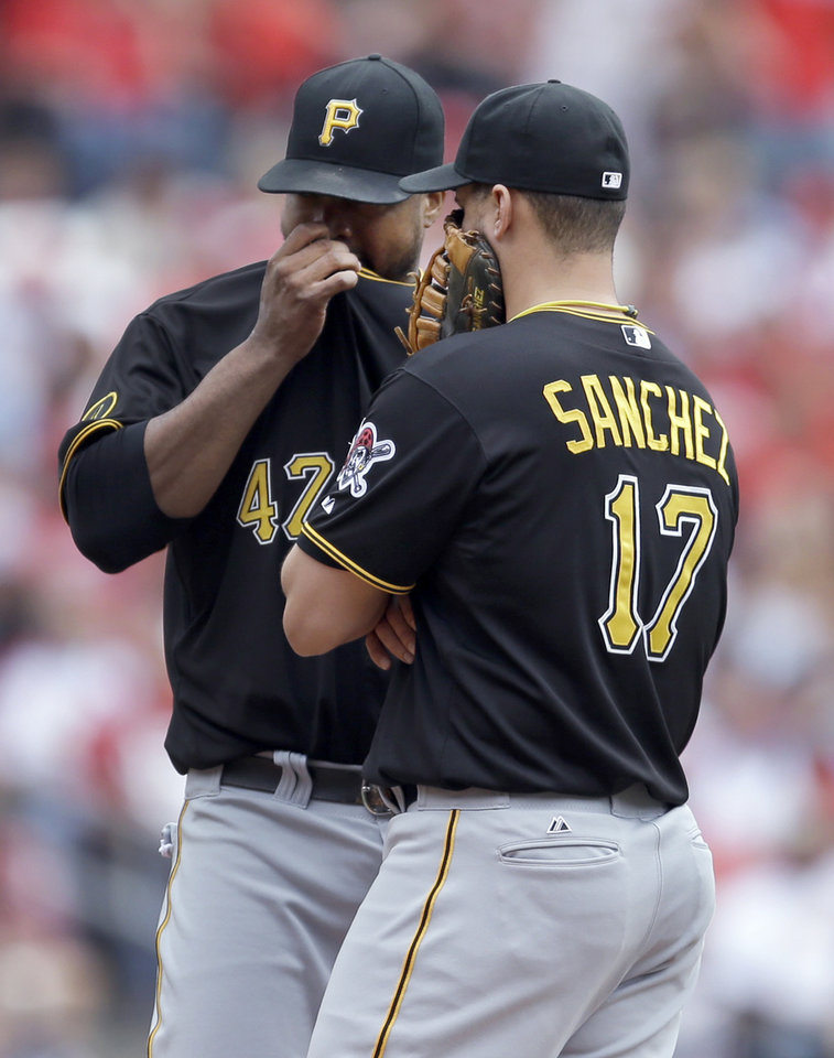 Photo - Pittsburgh Pirates starting pitcher Francisco Liriano talks with teammate Gaby Sanchez during the third inning of a baseball game against the St. Louis Cardinals on Saturday, April 26, 2014, in St. Louis. Liriano left the game soon after. (AP Photo/Jeff Roberson)