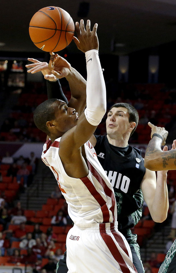 Photo - Oklahoma's Buddy Hield (3) has the ball knocked away by Ohio's Ivo Baltic (23) during a NCAA college basketball game between the University of Oklahoma (OU) and Ohio at the Lloyd Noble Center in Norman, Saturday, Dec. 29, 2012. Photo by Bryan Terry, The Oklahoman