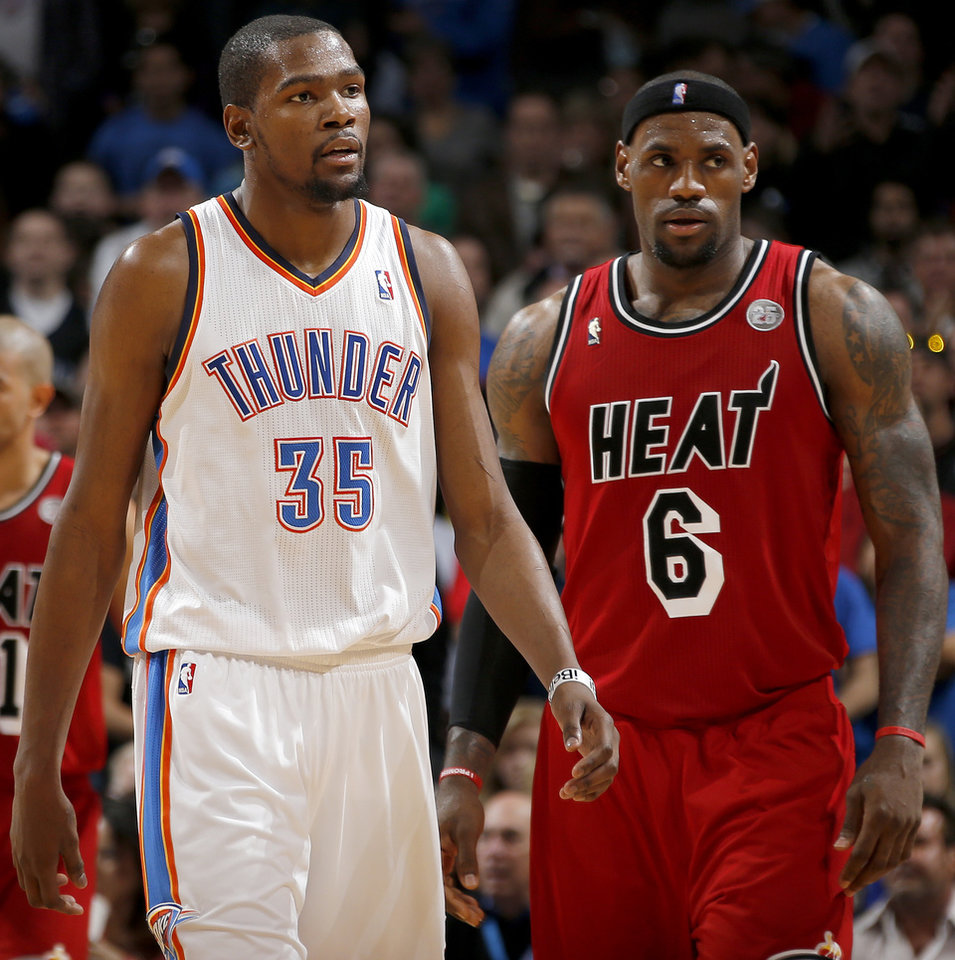 Oklahoma City\'s Kevin Durant (35) walks by Miami\'s LeBron James (6) during an NBA basketball game between the Oklahoma City Thunder and the Miami Heat at Chesapeake Energy Arena in Oklahoma City, Thursday, Feb. 15, 2013. Miami won 110-100. Photo by Bryan Terry, The Oklahoman