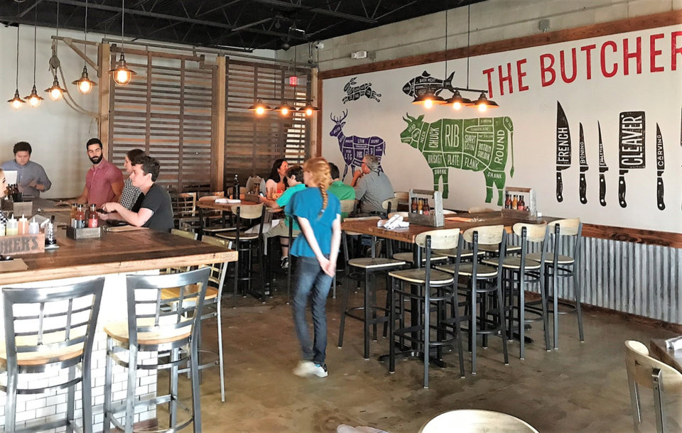 Photo - The Smoking Boar opened in northwest Oklahoma City last week. [Dave Cathey/The Oklahoman]