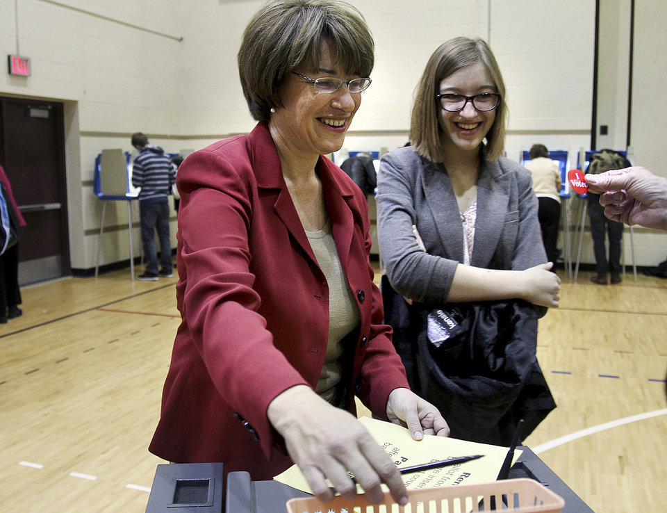 Photo -   Sen. Amy Klobuchar, D-Minn., left, laughs as she joins her husband John Bessler, not shown, and daughter Abigail Klobuchar Bessler to cast her vote at Marcy School, Tuesday, Nov. 6, 2012, in Minneapolis, Minn. (AP Photo/The Star Tribune, Elizabeth Flores) MANDATORY CREDIT; ST. PAUL PIONEER PRESS OUT; MAGS OUT; TWIN CITIES TV OUT