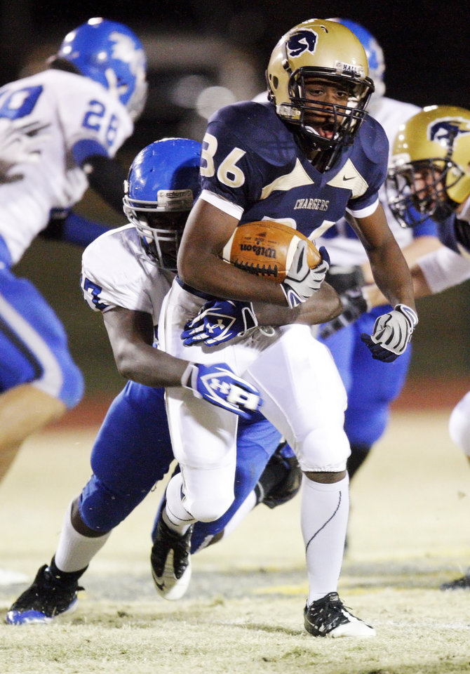 Brent Gaddis (36) of Heritage Hall carries the ball during the high school football playoff game between Bridge Creek and Heritage Hall at Heritage Hall School in Oklahoma City, Friday, Nov. 19, 2010. Photo by Nate Billings, The Oklahoman