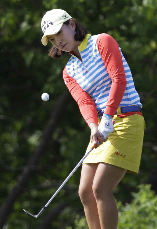 Photo - Hee Young Park, of South Korea, chips up to the 18th green during the rain-delayed second round of the Kingsmill Championship LPGA golf tournament in Williamsburg, Va., Friday, May 16, 2014. Park finished with a 3-under-par 68, leaving her at 8 under for the tournament.  (AP Photo/Steve Helber)