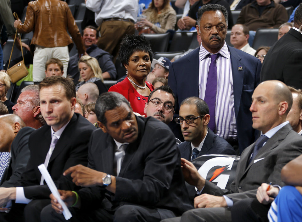 The Rev. Jesse Jackson stands behind the Thunder bench during an NBA basketball game between the Oklahoma City Thunder and the Denver Nuggets at Chesapeake Energy Arena in Oklahoma City, Tuesday, March 19, 2013. Denver won 114-104. Photo by Bryan Terry, The Oklahoman