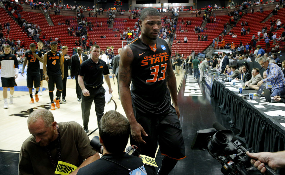 Photo - Marcus Smart walks off the court after losing in a second round game of the NCAA men's college basketball tournament at Viejas Arena in San Diego, between Oklahoma State and Gonzaga Friday, March 21, 2014. Gonzaga won 85-77. Photo by Bryan Terry, The Oklahoman