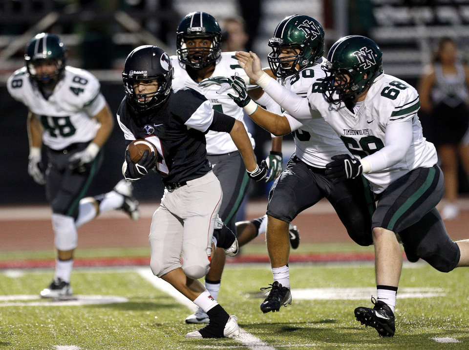 Yukon's Jacob Roush tries to out run the Norman North defense during a high school football game between Yukon and Norman North in Yukon, Okla.,   Friday, Oct. 4, 2013. Photo by Sarah Phipps, The Oklahoman
