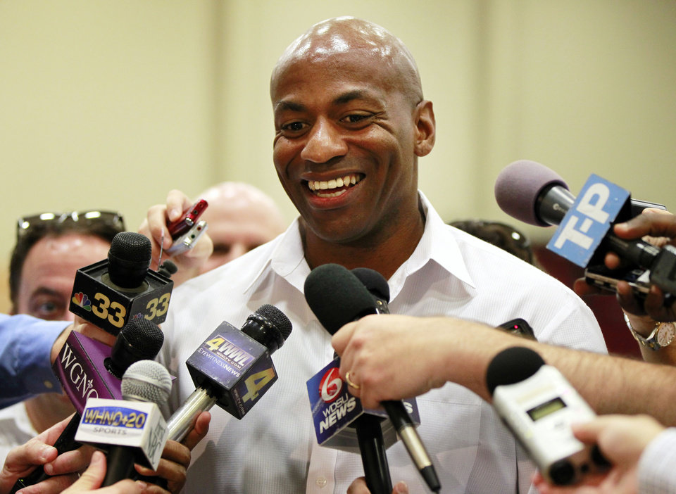FILE - This June 19, 2012 file photo shows New Orleans Hornets general manager Dell Demps talking to reporters at their practice facility in Westwego, La. Demps has agree to a new multi-year contract extension with the club. The Hornets announced the deal on Friday, Nov. 16, 2012, but did not release terms of the contract. Hornets executive vice president Mickey Loomis says Demps