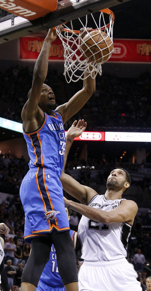 Photo - Oklahoma City's Kevin Durant (35) dunks the ball over San Antonio's Tim Duncan (21) during Game 2 of the Western Conference Finals in the NBA playoffs between the Oklahoma City Thunder and the San Antonio Spurs at the AT&T Center in San Antonio, Wednesday, May 21, 2014. Photo by Sarah Phipps, The Oklahoman