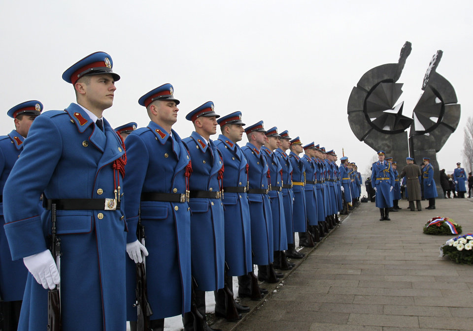 Photo - A Serbian military honor guard stand to attention during commemorations for victims of the Holocaust at a monument erected in the former World War II Nazi concentration camp of Sajmiste in Belgrade, Serbia, Sunday, Jan. 27, 2013. The ceremony coincided with International Holocaust Remembrance Day, which marks the liberation of the Auschwitz Nazi concentration camp on Jan. 27, 1945. (AP Photo/Darko Vojinovic)