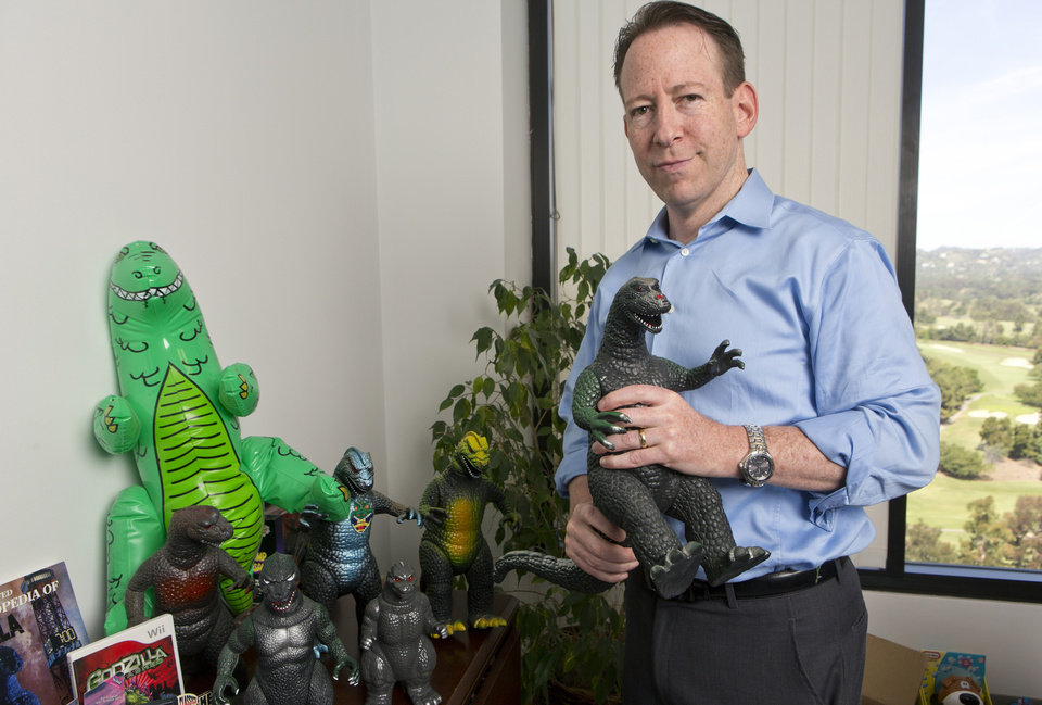 Photo -   Entertainment and intellectual property litigation attorney Aaron Moss, of Greenberg Glusker, shows a licensed, original Godzilla Imperial product at his Century City office in Los Angeles.  AP Photo   Damian Dovarganes -